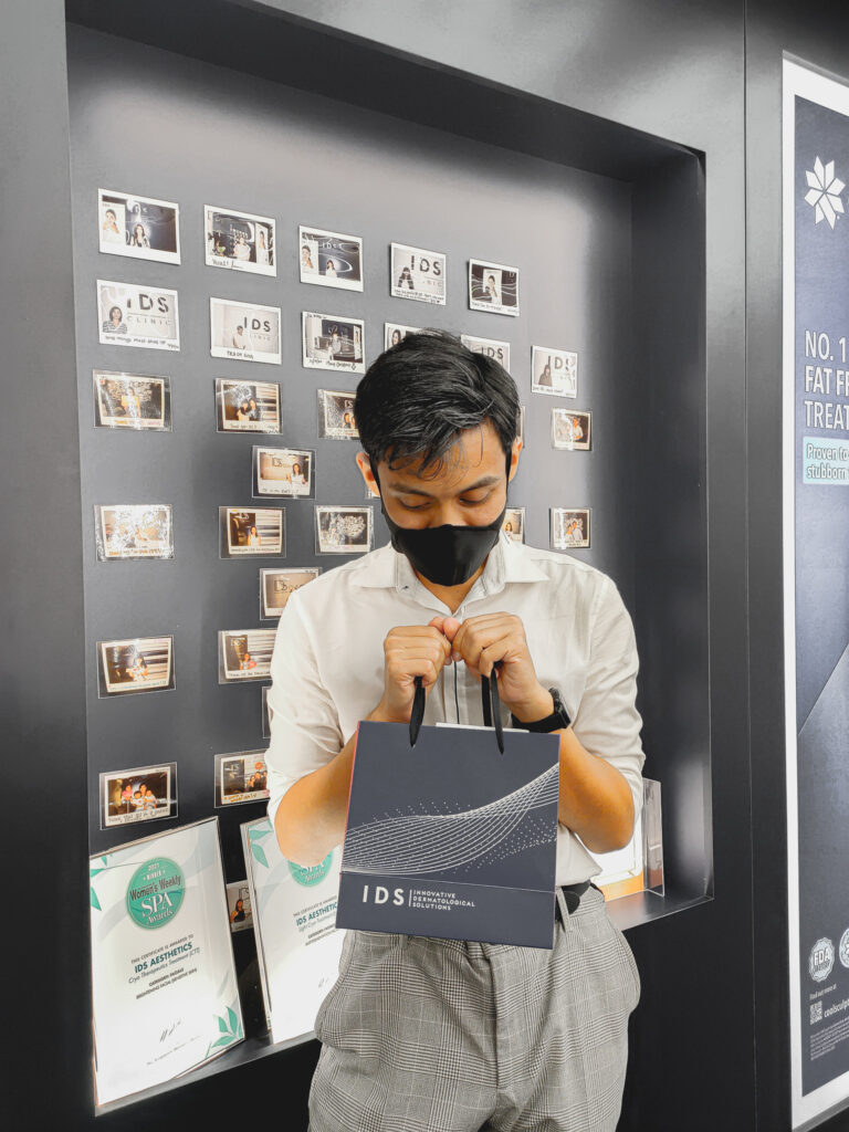 Eddy Chua looking satisfied with his IDS skincare product replenishment.
